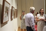 image of visitors looking at exhibition opening of Mervyn Bishops show